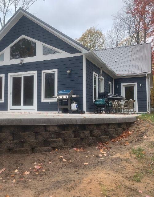 Custom Home 3 Car Garage Concrete Patio OverHang 1